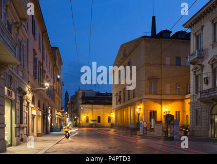 PARMA, ITALY - APRIL 17, 2018: The street of the old town at dusk and the Teatro Regio theater. - Stock Photo