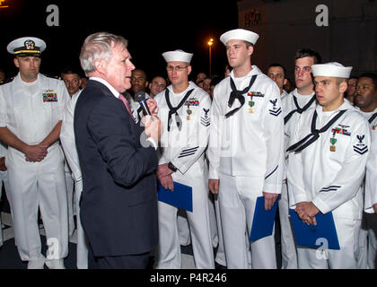 Secretary of the Navy Ray Mabus, second from left, speaks with U.S. Sailors during an all-hands call aboard the guided missile frigate USS Simpson (FFG 56) in the Republic of Cape Verde April 10, 2012. Mabus commended the crew for their participation in Africa Partnership Station (APS). APS is an international security cooperation initiative facilitated by Commander, U.S. Naval Forces Europe-Africa aimed at strengthening global maritime partnerships through training and collaborative activities in order to improve maritime safety and security in Africa. (DoD - Stock Photo