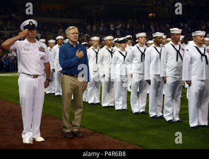 .SAN DIEGO (Sept. 25, 2012) Secretary of the Navy (SECNAV) Ray Mabus places his hand over his heart during the national anthem before a Major League Baseball game between the San Diego Padres and the Los Angeles Dodgers at Petco Park. Mabus conducted a reenlistment ceremony for 91 Sailors from the San Diego area and threw out the ceremonial first pitch. - Stock Photo