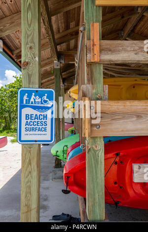 Kayaks for rent on wooden rack at marina with beach access sign - West Lake Park, Hollywood, Florida, USA - Stock Photo