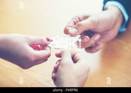 Finally finding solution concept with jigsaw - Stock Photo