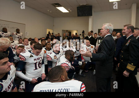 Secretary of the Navy (SECNAV) Ray Mabus congratulates the U.S. Naval Academy Midshipmen in the locker room for beating the Army Black Knights for the 13th consecutive year. Navy beat Army 17-10. - Stock Photo