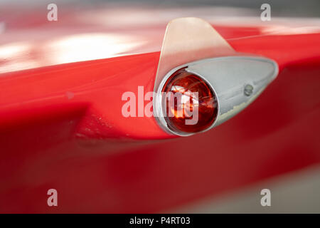 Wing of an airplane with red position light - Stock Photo