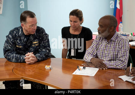 Chairman of the Joint Chiefs of Staff Navy Adm. Mike Mullen meets with Haitian President Rene Garcia Preval during a visit to Port Au Prince, Haiti on Feb. 26, 2010. (DoD - Stock Photo