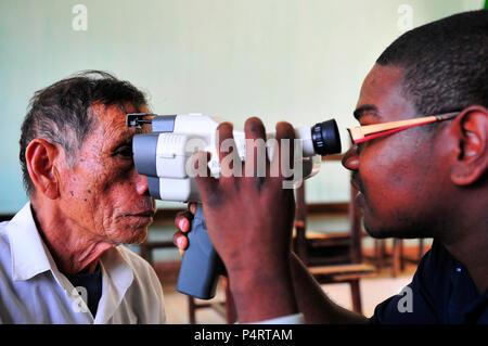 U.S. Navy Hospital Corpsman 2nd Class Cahlil Weaver, assigned to the Military Sealift Command hospital ship USNS Mercy (T-AH 19), uses an auto refractor to check a patient?s vision during a Pacific Partnership 2010 medical civic action program at the Phuoc Hoa Secondary School in Vietnam June 5, 2010. Pacific Partnership is an annual U.S. Pacific Fleet-sponsored humanitarian civic assistance endeavor aimed at strengthening regional relationships with host and partner nations in Southeast Asia and Oceania. (DoD - Stock Photo