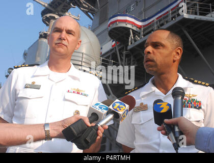 U.S. Navy Capt. Baxter Goodly, right, the commanding officer of the amphibious assault ship USS Kearsarge (LHD 3), and Navy Capt. Larry Grippin, the commodore of Commander, Amphibious Squadron 4, conduct a press briefing prior to departing Naval Station Norfolk, Va., Aug. 27, 2010. Kearsarge is departing to provide assistance to flood-stricken regions of Pakistan. (DoD - Stock Photo