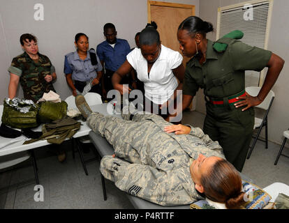U.S. Navy Chief Hospital Corpsman Tracie Ham, with Maritime Civil Affairs and Security Training, observes as members of the Guyana Defense Force practice medical techniques on Air Force Tech Sgt. Yvonne Martino during a medical subject matter expert exchange aboard high speed vessel Swift (HSV-2) in Georgetown, Guyana, Sept. 6, 2010. Swift is deployed in support of Southern Partnership Station 2010, which is designed to promote information-sharing with navies, coast guards and civilian services throughout the U.S. Southern Command area of responsibility. (DoD - Stock Photo