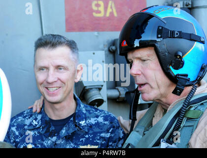 Commandant of the Marine Corps Gen. James Amos, right, stands with Navy Capt. Thom Burke, the commanding officer of USS Ronald Reagan (CVN 76), after arriving aboard the ship Nov. 5, 2010, under way in the Pacific Ocean. Amos visited the Ronald Reagan to celebrate the 235th birthday of the Marine Corps with Marines from Marine Fighter Attack Squadron 323. (DoD - Stock Photo