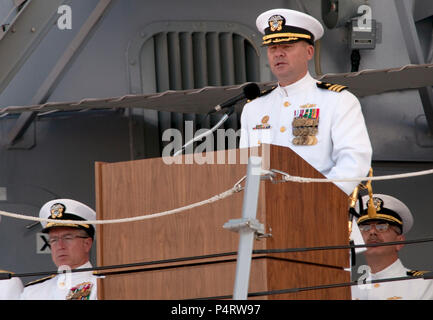 U.S. Navy Cmdr. Scott Sciretta, the commanding officer of the Arleigh Burke-class guided missile destroyer USS Jason Dunham (DDG 109), speaks during the ship?s commissioning ceremony in Port Everglades, Fla., Nov. 13, 2010. The ship was named after U.S. Marine Corps Cpl. Jason Dunham, who was mortally wounded in Iraq in April 2004 and posthumously awarded the Medal of Honor. (DoD - Stock Photo