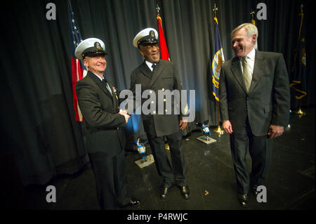 Master Chief Petty Officer of the Navy Rick West, left, and Secretary of the Navy Ray Mabus congratulate Honorary Chief Hospital Corpsman Bill Cosby, center, during his pinning ceremony at the Navy Memorial in Washington, D.C., Feb. 17, 2011. (DoD - Stock Photo