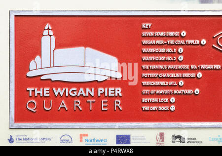 Sign for The Wigan Pier Quarter, made famous by George Orwell, in Lancashire in NW England, UK - Stock Photo