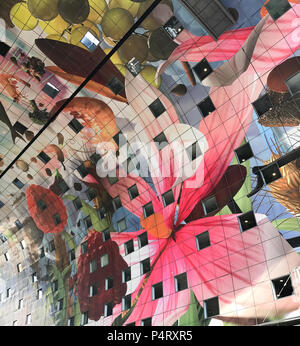 The colourful painted arch ceiling of the Markthal,  famous market hall in central Rotterdam - Stock Photo
