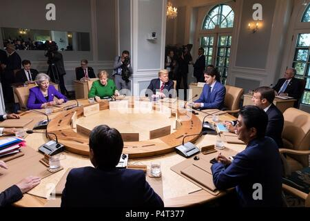 U.S. President Donald Trump and world leaders attends a working session of the Charlevoix G7 Summit June 8, 2018 in Charlevoix, Quebec, Canada. Sitting from left to right are:  British Prime Minister Theresa May, German Chancellor Angela Merkel, President Donald Trump, Canadian Prime Minister Justin Trudeau, French President Emmanuel Macron, Japanese Prime Minister Shinzo Abe and Italian Prime Minister Giuseppe Conte. - Stock Photo