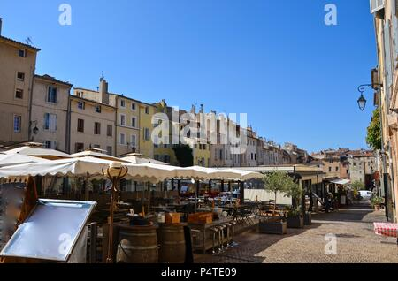 The medieval town Aix-en-Provence in France, restaurants, tourism, medieval house facades, lavender, wine, french lifestyle, people - Stock Photo