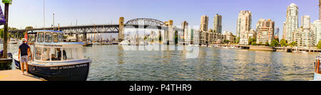 Vancouver British Columbia skyline from a very sunny day in Panoramic format. Taken from Plaza of the nations dock - Stock Photo