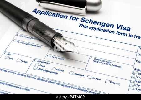 close up from a Application for Schengen visa and passport - Stock Photo