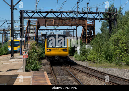 A British Rail Class 142 Pacer train passes through the run-down Ardwick railway station in Manchester. - Stock Photo