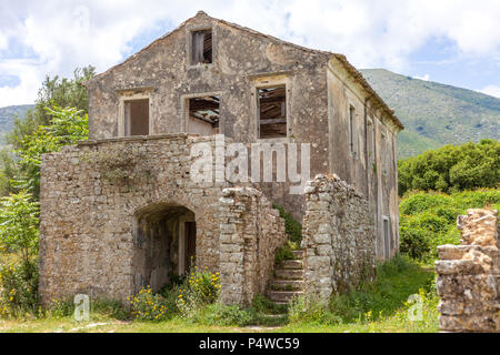 Ancient house built with concrete. Flowering plants growing in the ground. Wooden blocks falling from the ceiling. Ruins during medieval era. History  - Stock Photo