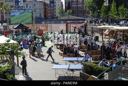 Reading, United Kingdom - June 22 2018:   Fans gather at an outdoor bar on Station Hill to watch Nigeria against Iceland in the 2018 Football world cu - Stock Photo