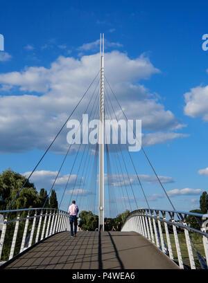 Reading, United Kingdom - June 21 2018:   Pedestrians on Christchurch Suspension Bridge over the River Thames - Stock Photo