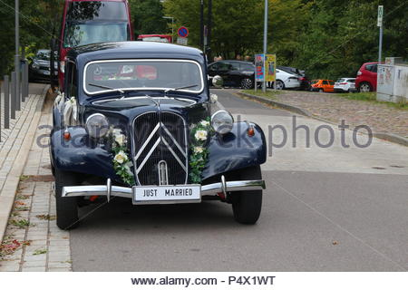 Karlsruhe / Germany: Oct 07 2017: Vintage car decorated for wedding - Stock Photo