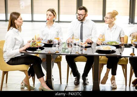 Business people during a lunch at the restaurant - Stock Photo