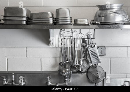 Restaurant Commercial Kitchen Stainless Steel Cooking Utensils - Stock Photo