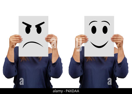 Woman holding cardboard with angry and smile face isolated on white - Stock Photo
