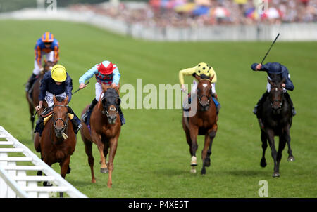 Crystal Ocean (left) ridden by Jockey Ryan Lee Moore on their way to win the Hardwicke Stakes during day five of Royal Ascot at Ascot Racecourse. - Stock Photo