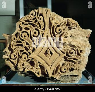 Spain. Catalonia. Balaguer. Islamic Art. Fragment of plasterwork from Sudda or governor's residence. Built by governor Yusuf al-Muzaffares (1045-1082). Detail arch. Museo  Comarcal de la Noguera. - Stock Photo
