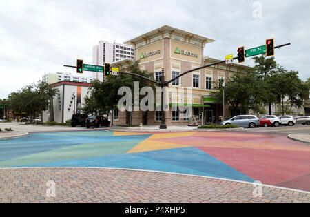 St Petersburg, Florida, USA, A branch of Regions Bank overlooking a brightly painted highway downtown St Peterburg Fl, USA - Stock Photo