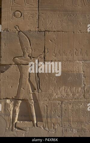 Relief depicting a Pharaoh making libations to the gods. Ramesseum. 13th century. Nineteen dynasty. New Kingdom. Necropolis of Thebes. Valley of the kings. Egypt. - Stock Photo