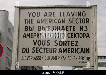 Checkpoint Charlie. The most famous of the crossing points of the Berlin Wall between the two parts of the city. Placard. Berlin. Germany. - Stock Photo