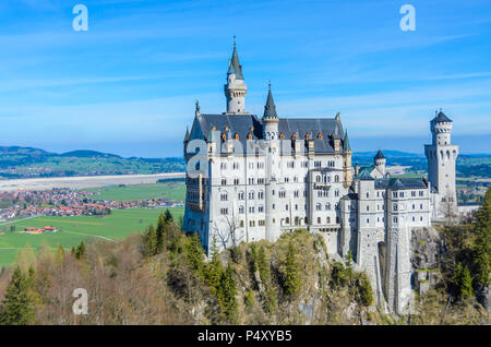 Neuschwanstein Castle, the nineteenth-century Romanesque Revival palace built for King Ludwig II on a rugged cliff near Fussen, Bavaria, Germany - Stock Photo