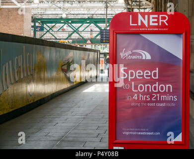 LNER advertisement for East Coast train route, taking over Virgin East Coast trains, Waverley Railway Station, Edinburgh, Scotland, UK - Stock Photo
