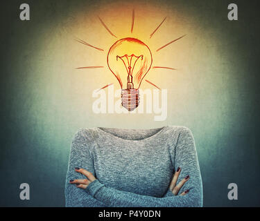 Surreal image as a serious woman with a bulb instead of head stand with crossed hands. Incognito person with hidden face has a solution to every probl - Stock Photo