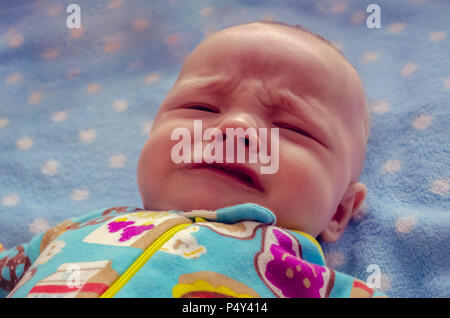 Bright photo of crying three month old baby boy - Stock Photo