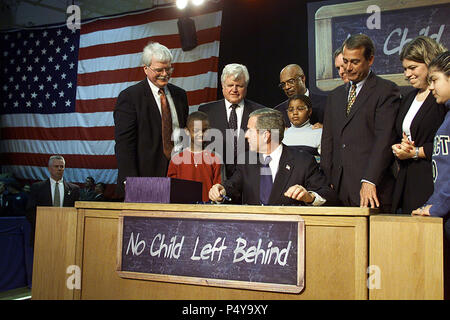 President George W. Bush signs into law the No Child Left Behind Act Jan. 8, 2002, at Hamilton High School in Hamilton, Ohio. Pictured from left are: Democratic Rep. George Miller of California, Democratic U.S. Sen. Edward Kennedy of Massachusetts, Secretary of Education Rod Paige, Republican Rep. John Boehner of Ohio, and Republican Sen. Judd Gregg of New Hampshire. - Stock Photo