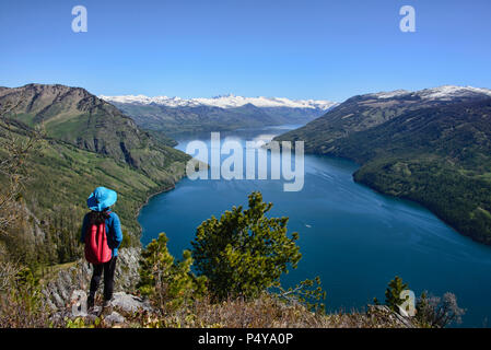 Enjoying the view, Kanas Lake National Park, Xinjiang, China - Stock Photo