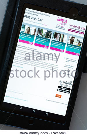Women's Aid Refuge app on an android tablet PC Dorset England UK - Stock Photo