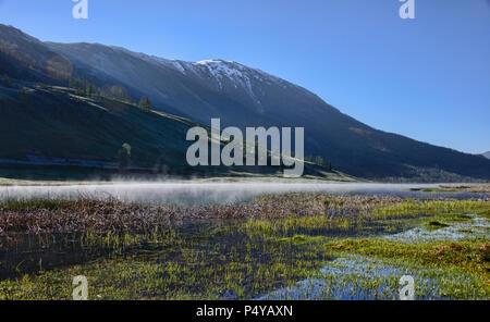 Mist at the Yaze Lake, Kanas Lake National Park, Xinjiang, China - Stock Photo