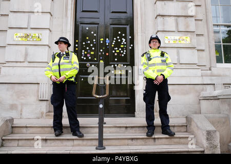 People's Vote, London, UK,  23rd June 2018. Police officers stand guard outside the governments Cabinet Office in Whitehall after the doors had been plastered with many Stop Brexit stickers by anti Brexit protesters - Photo Steven May /Alamy Live News - Stock Photo