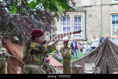 Barnard Castle, Teesdale, County Durham. Saturday 23rd June 2018. The North East Market Town of Barnard Castle took a step back in time today when people dressed up in vintage 1940's clothes and 2nd World War uniforms as part of the Barnard Castle 1940's Weekend. This included a flypast by a WW2 Spitfire and displays by re-enactors.  David Forster/Alamy Live News - Stock Photo