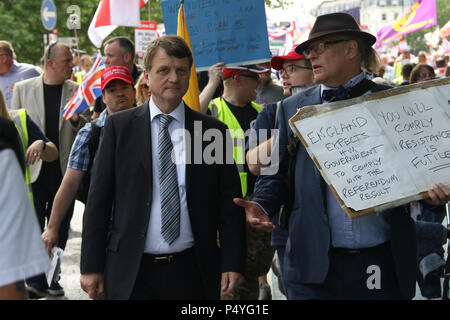 London, England. 23rd June 2018. To mark the second anniversary of the Brexit vote, which saw Britain vote to leave the EU, patriotic, pro-British people travelled from across Great Britain to march from Carlisle Place, near Victoria train station to Parliament. Pictured: Gerard Batten, MEP & UKIP Leader joins the marchers. Credit: Richard Milnes/Alamy Live News - Stock Photo