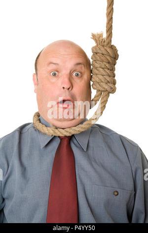 A businessman in noose, a cut backs, financial crisis concept. - Stock Photo