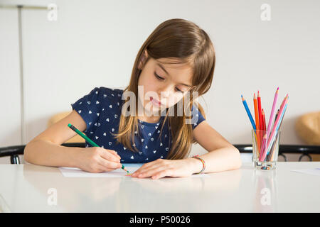 Portrait of little girl drawing - Stock Photo