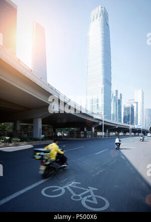 China, Beijing, High-rise building and traffic on road - Stock Photo
