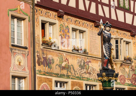 Switzerland, Stein am Rhein, Old town, historical houses at townhall square, fresco paintings, sculpture on fountain - Stock Photo