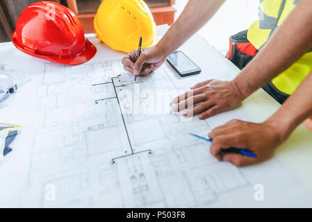 Close-up of workers hands, working on construction plane - Stock Photo