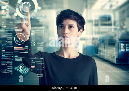 Young woman using transparent touchscreen display, Composing - Stock Photo